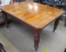 A late 19th / early 20th century oak dining table with a rectangular top and cut corners on