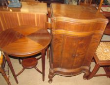 A reproduction mahogany occasional table of circular form,