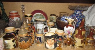 A Japanese Kutani vase together with steins, fruit bowls, character jugs,