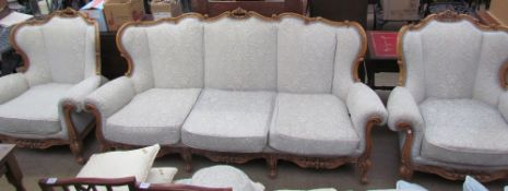 A continental upholstered three piece suite,