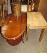 A reproduction yew wood coffee table of oval form together with an oak nest of two tables and a