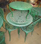 A garden table and three chairs together with a coffee table