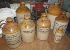 A Pickup Bros Pontypridd stoneware flagon together with a collection of stoneware flagons including