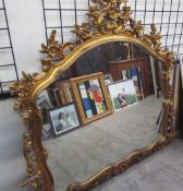 A gilt decorated wall mirror,