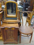A bentwood dining chair together with a pine toilet mirror and a coal purdonium.