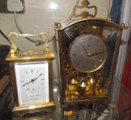 A Morell & Hilton carriage clock and an anniversary clock