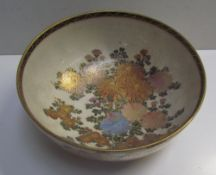 A Japanese satsuma pottery bowl, decorated with flowerheads and leaves,