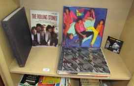 Rolling Stones, Slow rollers together with a collection of Rolling Stones albums,