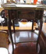 A 20th century continental marble topped side table of kidney shape with a gilt metal gallery above