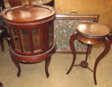 A mahogany tray top display cabinet with bevelled glass panels on square tapering legs together