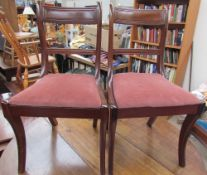 A set of six late Regency style mahogany dining chairs,