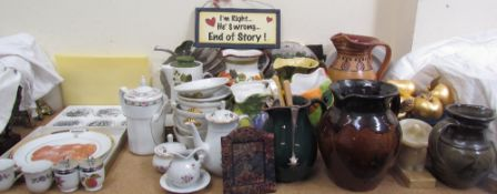A studio pottery jug together with other pottery jugs, plates, egg coddlers,
