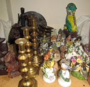 A collection of Franklin Mint porcelain bells with bird and butterfly mounts, brass candlesticks,