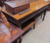 A 20th century oak refectory dining table of rectangular form on turned legs together with a teak