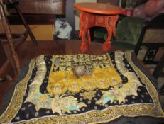 A Rangoon wall hanging with bead and padded decoration together with a Burmese lacquer table and a