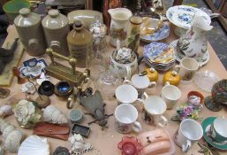 Stoneware foot warmers together with a storage jar, copper flask, jugs, plates, commemorative wares,