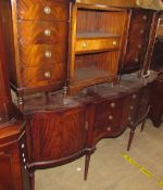 A reproduction mahogany sideboard together with a pair of reproduction mahogany bedside chests,