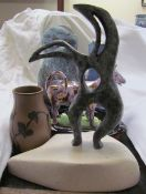 An abstract bronze sculpture together with a Josie Walter cat painted dish,