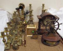 A brass pillar telephone, together with brass candlesticks, brass clock,