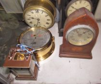 A Matthew Norman carriage clock together with a bulk head time piece,