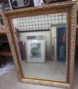 A gilt framed wall mirror of rectangular form