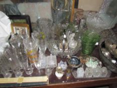 Assorted glass vases, glass bowls, drinking glasses,