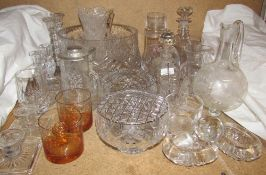 A large glass fruit bowl together with glass candlesticks,