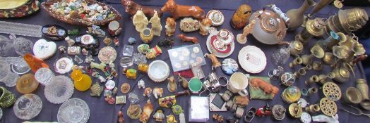 A large lot including various pottery dogs together with brass wares, Limoges, coin set,
