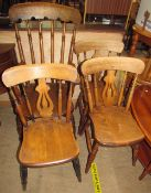 A kitchen spindle back elbow chair together with a set of three kitchen dining chairs