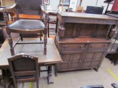 A 20th century oak drawleaf dining table together with a set of five oak chairs and a court
