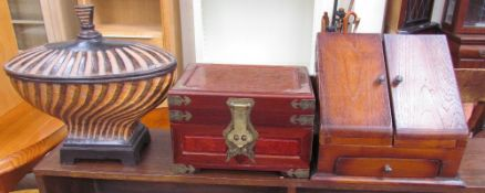 An Edwardian style stationery box together with an Oriental hardwood jewellery box and a resin urn