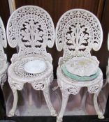 A pair of white painted garden chairs together with plaques of fairies etc