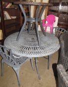 Garden furniture - a metal table and three chairs together with a glass topped table,