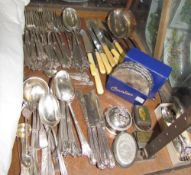 A silver mustard spoon together with silver handled knives,