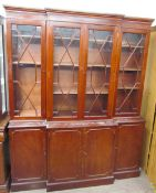 A reproduction mahogany breakfront bookcase, the with a moulded cornice above three astragal doors,