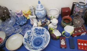 A Chinese blue and white pottery bowl together with a blue and white porcelain vase and cover,