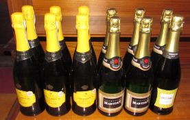 Five bottles of Martivey champagne together with six bottles of extra dry prosecco and a bottle of