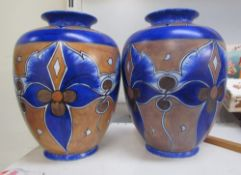 A pair of Clews & Co chameleon ware vases in blues and browns