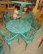 A green painted garden table and six chairs together with another table