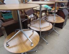 A set of six cafe tables with circular melamine tops on chrome columns and a four splayed legs