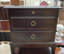A Stag bedside chest with a pull out slide and two drawers together with a double bed head and foot