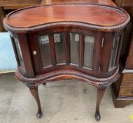 A 20th century mahogany kidney shaped display cabinet,