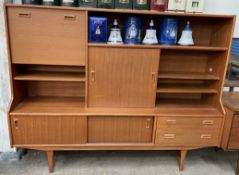 A Mid 20th century teak wall unit, with a drop down door,