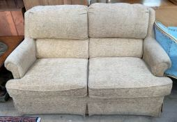 A modern upholstered two seater settee