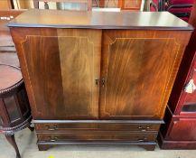 A mahogany television cabinet,