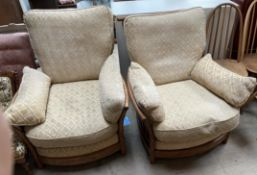 A pair of Ercol upholstered arm chairs,