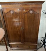 A 20th century mahogany wardrobe,