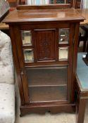 An Edwardian mahogany music cabinet,