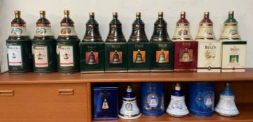 A collection of Bell's Old Scotch Whisky Christmas Decanters for 1989 - 1998 together with a