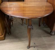 A 19th century mahogany gateleg dining table with an oval top on cabriole legs and pad feet